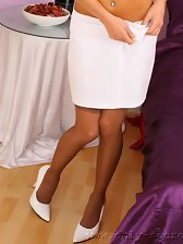 The stunning Isla looks delightful in her white skirt suit