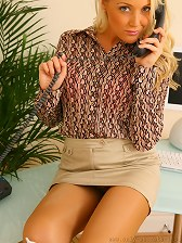 Lucy Anne looks stunning in this set as she seductively teases her way out of her sexy secretary outfit in the office